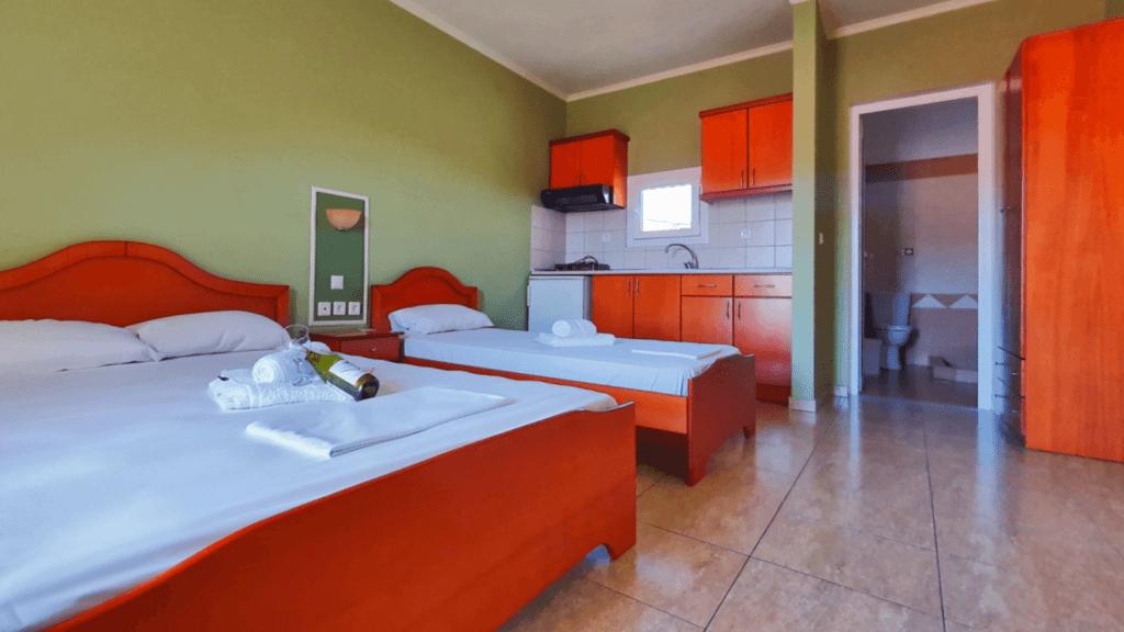 comfortable-room-three-beds-apartment-hotel-villa-maria-sarti-chalkidiki